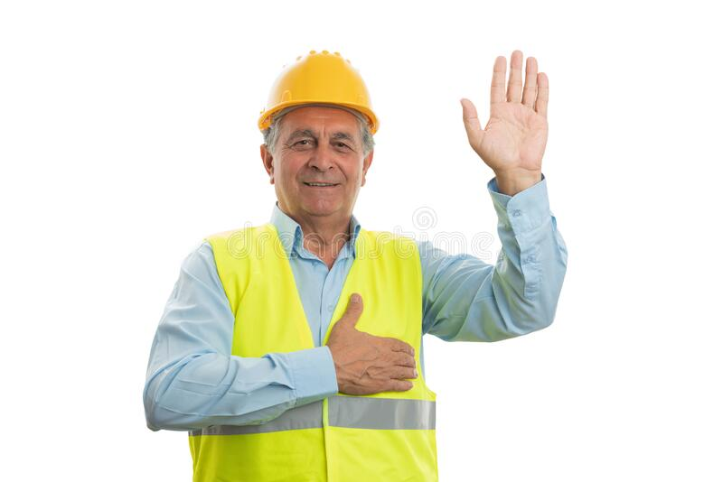 Builder making honest oath. Old male builder smiling as making honest oath touching chest and holding hand up isolated on white stock photos