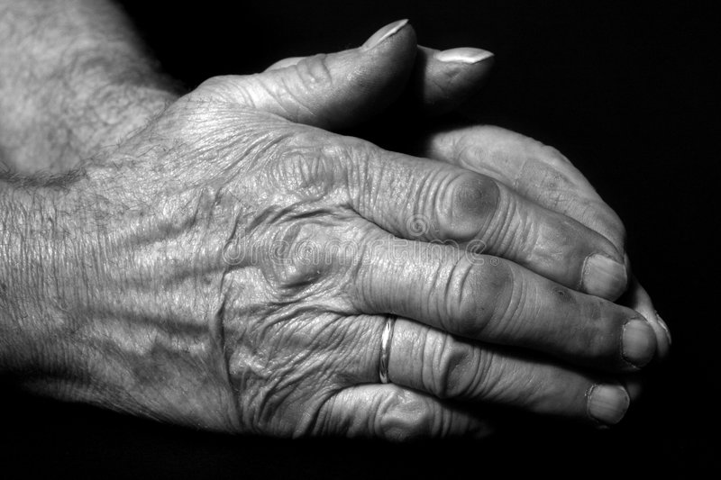 Old male praying hands royalty free stock photo