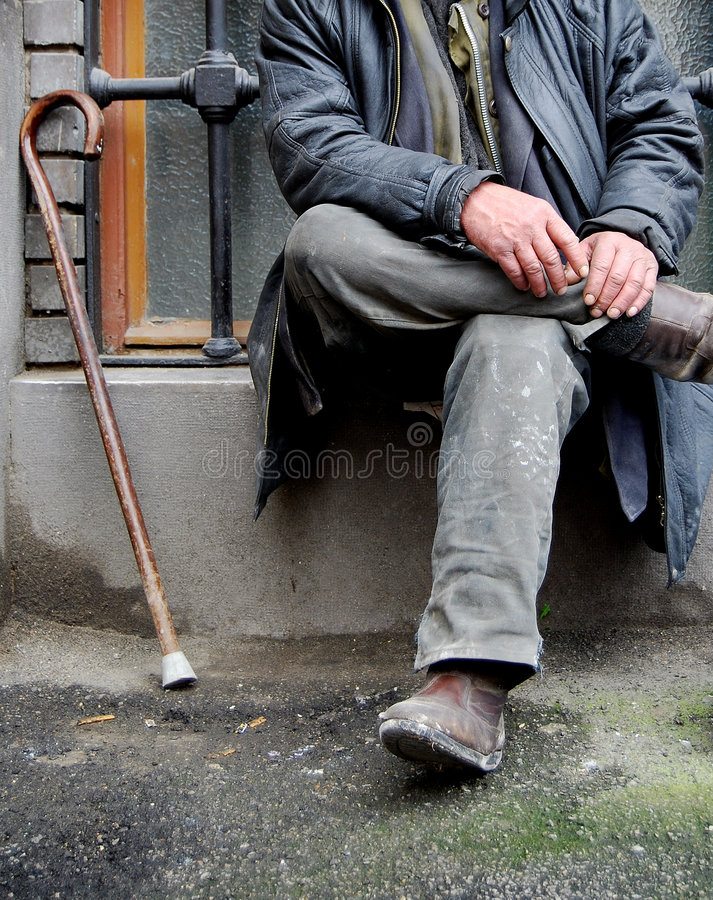 Old man. Homeless old man sitting and a cane stock photo