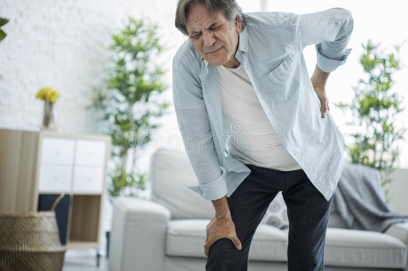 Old man with back pain royalty free stock photo