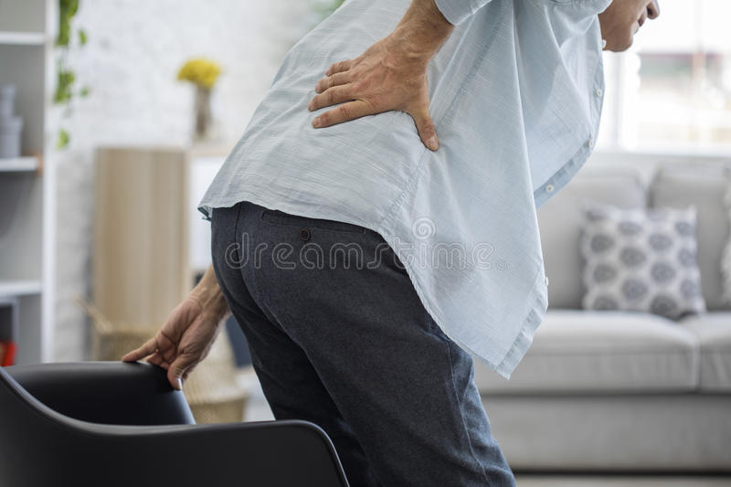 Old man with back pain. Old man standing with back pain royalty free stock photos
