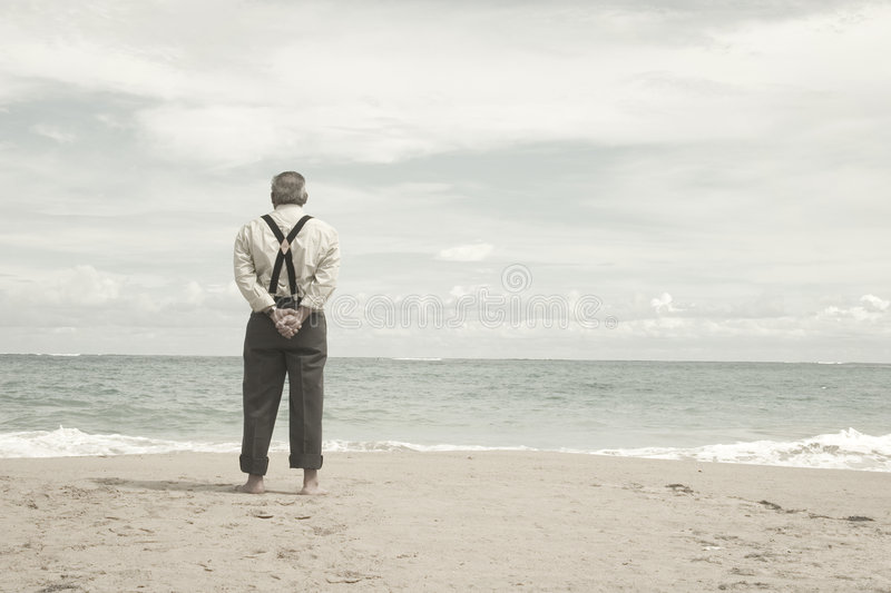 Old man and the beach stock photos