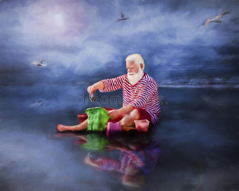 Old man on beach with bucket and green bag. Old man with white beard (Santa perhaps) on wet reflective beach with green bag and bucket (building sand castle) royalty free stock images