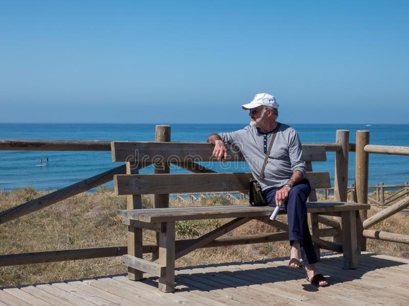 Sexy old grandpa on the beach