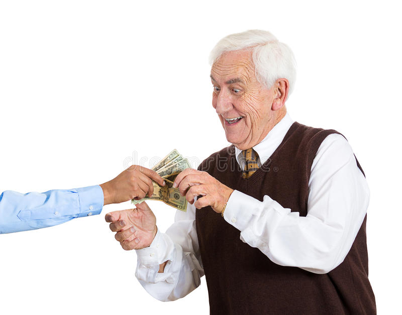 Old man being bribed. Closeup portrait, super excited, senior, mature man excited to have lots of money, dollar bills handed to him, isolated white background stock photo