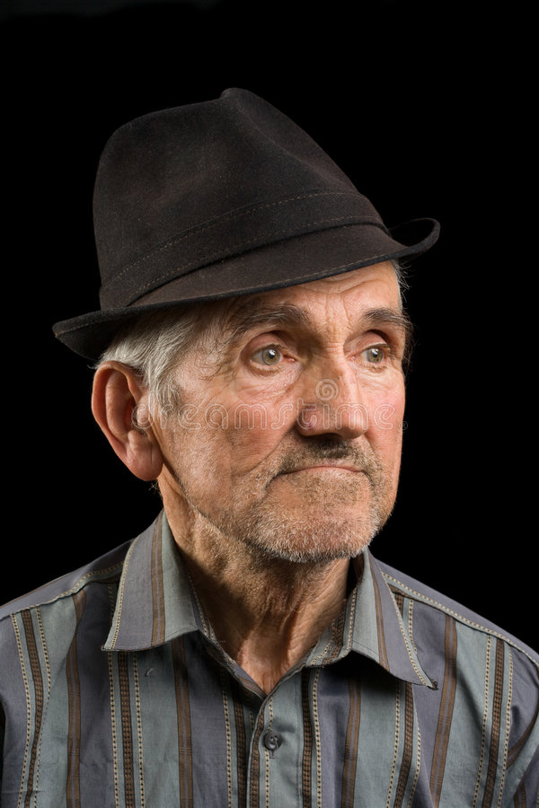 Old man with black hat royalty free stock images