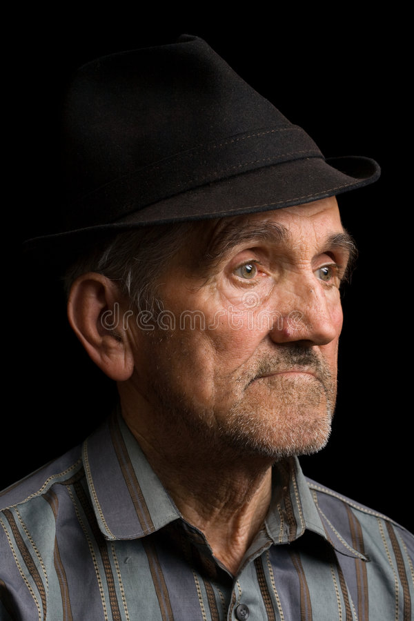 Old man with black hat royalty free stock photo