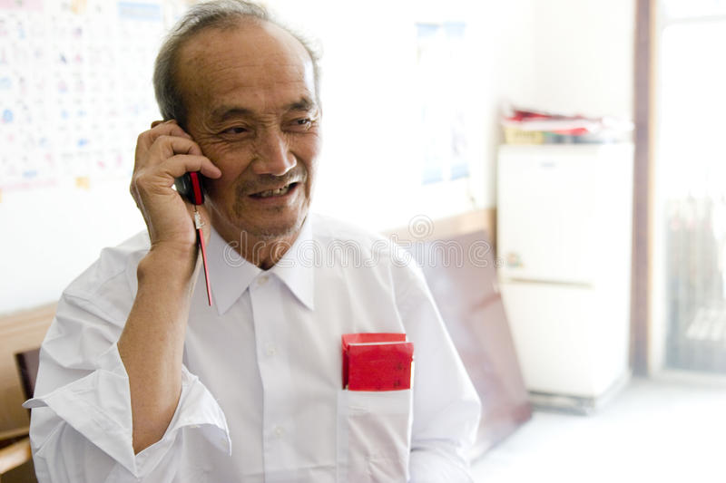 Download Old man calling phone stock photo. Image of smile, cellphone - 15104724