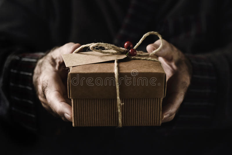 Old man with a christmas gift stock image