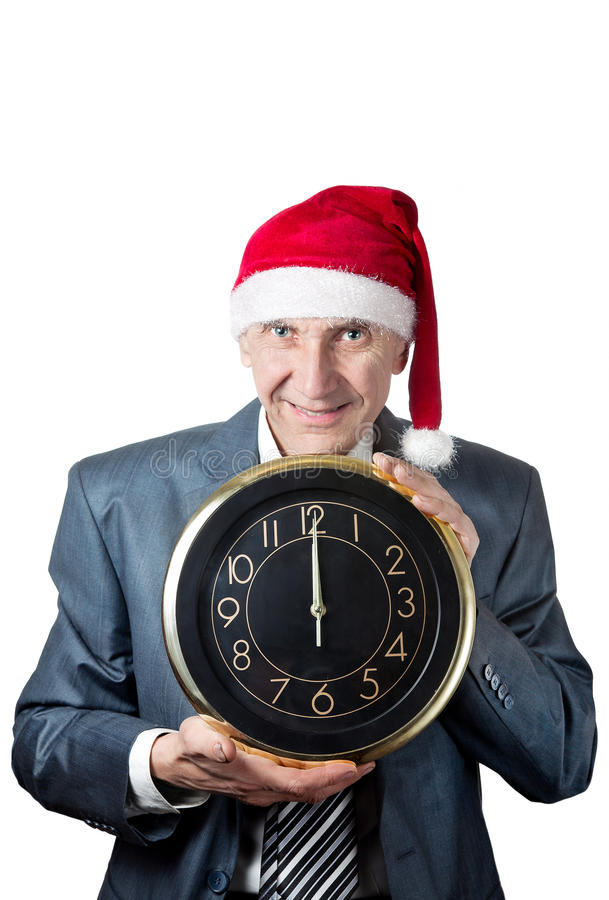 Old man in Christmas hat holding a big clock isola