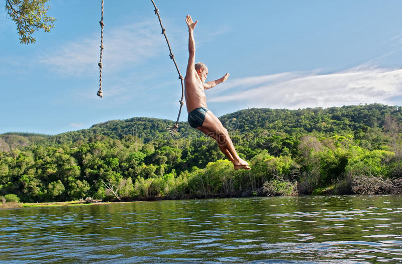 Old man dives into lake royalty free stock photography