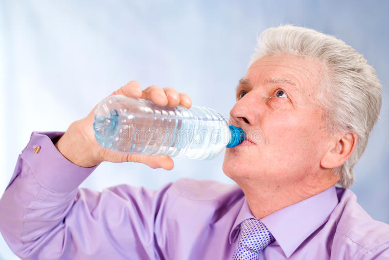 Download Old man drinks stock photo. Image of attractive, pensioner - 22629640