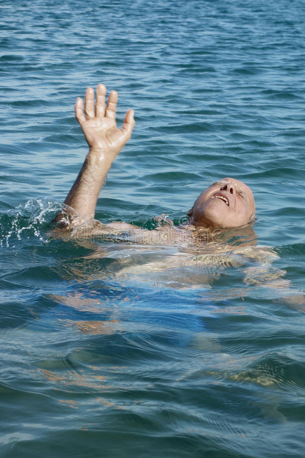Old Man Drowning Sea Help Stroke Pain royalty free stock image