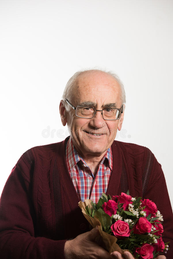 Old man with flowers stock images