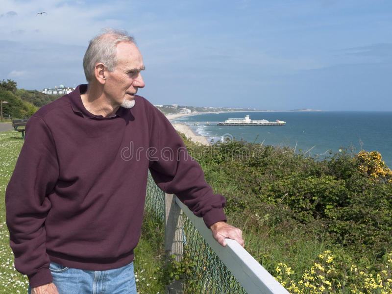 Old man gazing out at the ocean