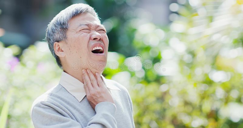 Old man throat pain royalty free stock images