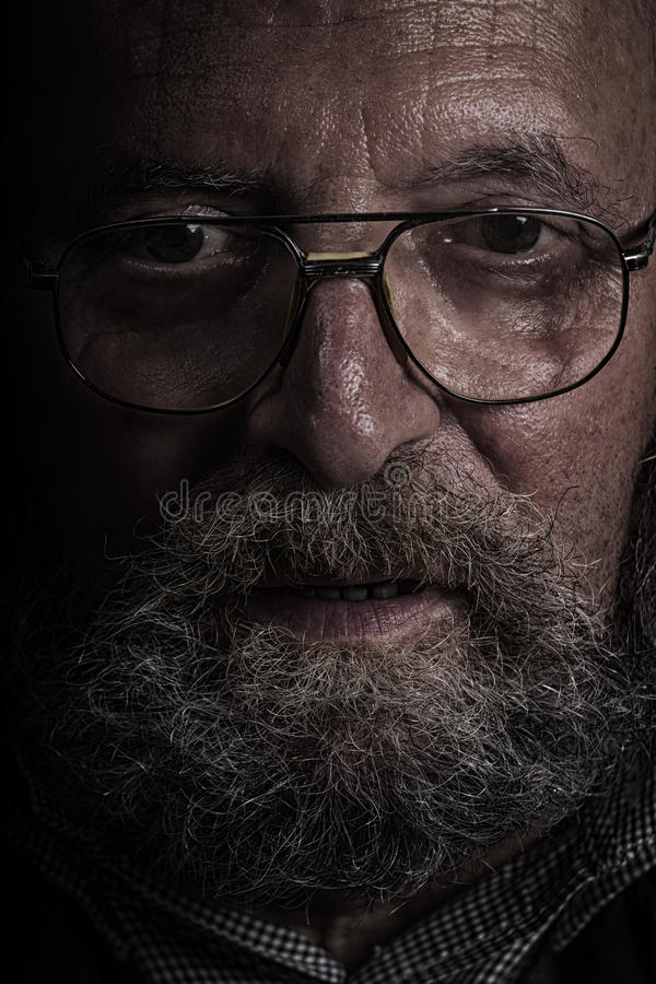 Old man with glasses and beard. Dragan effect stock photo