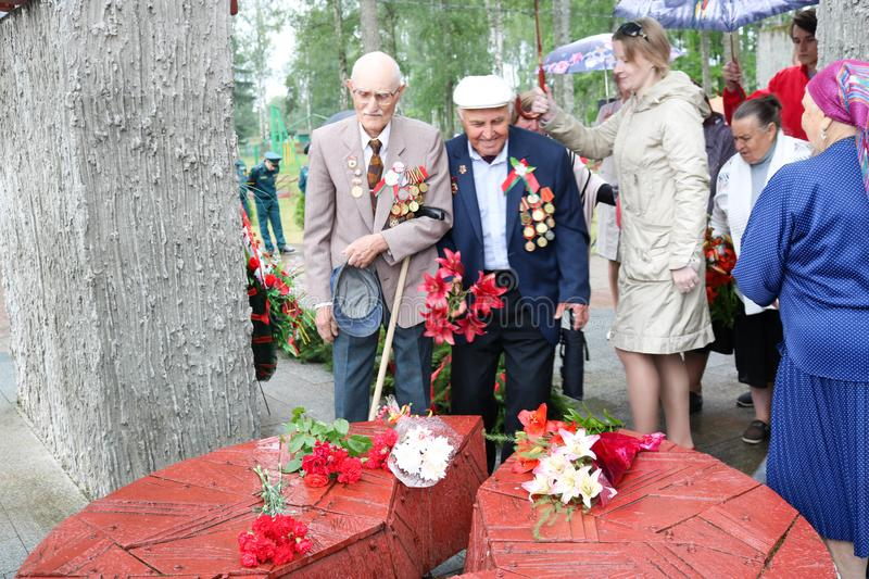 Old man grandfather veteran of World War II in medals and decorations puts cents Victory Day Moscow, Russia, 05.09.2018. Old man grandfather veteran of World War stock photo