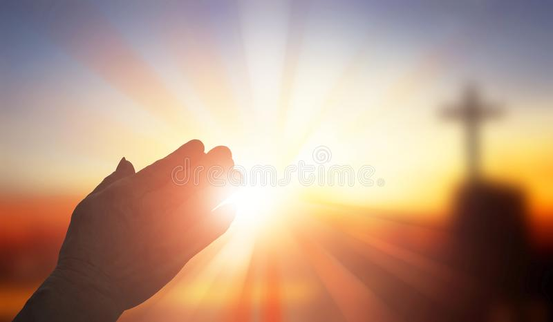Old man hand silhouette praying in religious city background royalty free stock photos