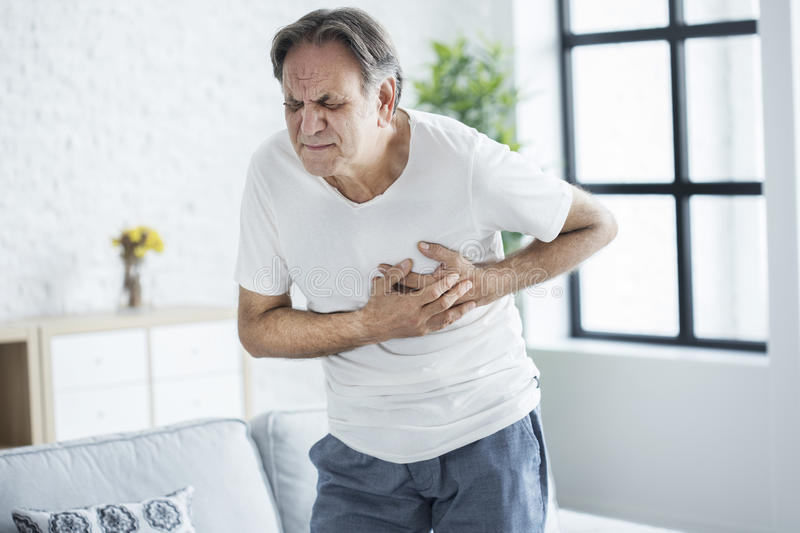 Old man with heart attack royalty free stock images