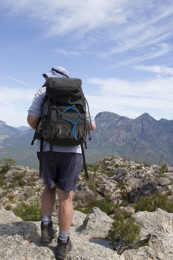 Old man hiking on mountain top 2 stock image