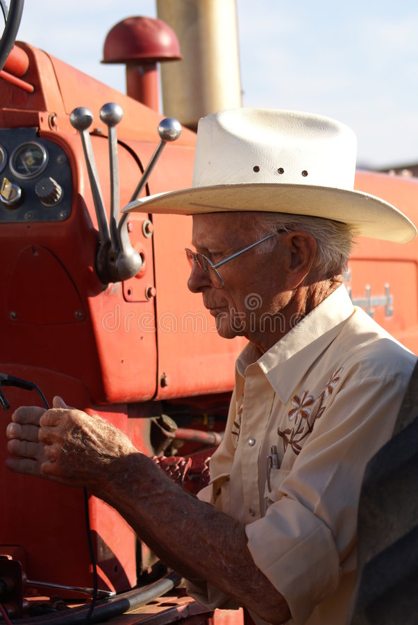 Old man and his tractor royalty free stock photography