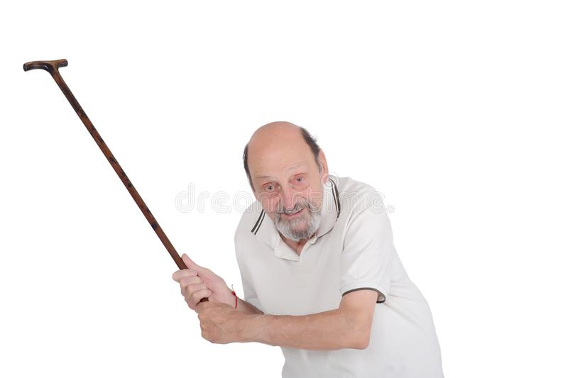 Old man holding a cane and scolding someone towards the camera. Portrait of displeased old man holding a cane and scolding someone towards the camera isolated on royalty free stock photos