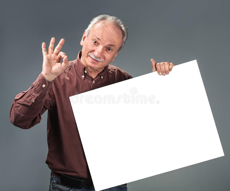 Download Old Man Holding Empty Billboard Stock Photos - Image: 27757183