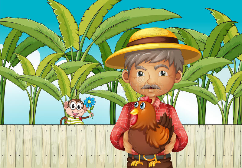 An old man holding a rooster standing in front of the fence with