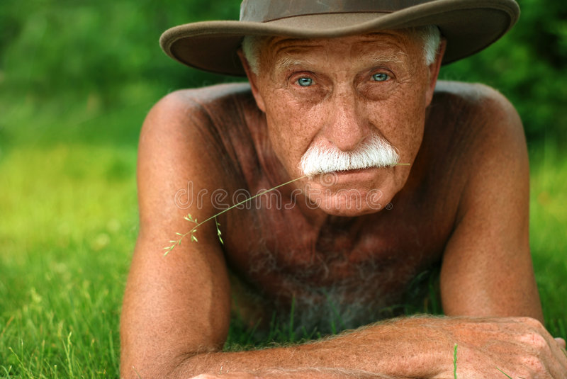 Old man on holidays royalty free stock photography
