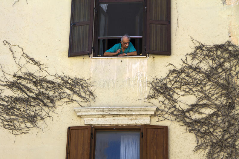 Download Old Man Leaning On A Window Editorial Stock Image - Image: 83704534