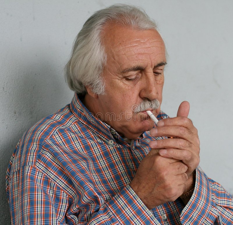 Download Old Man Lightening A Cigarette Royalty Free Stock Photos - Image: 9248108