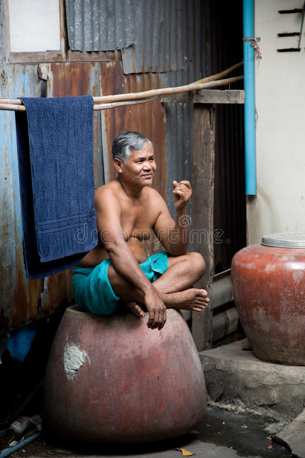 A old man living in a slum royalty free stock images