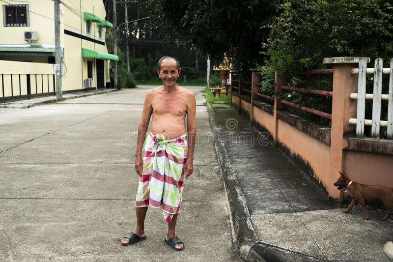 Old man with loincloth standing on public street. royalty free stock photo
