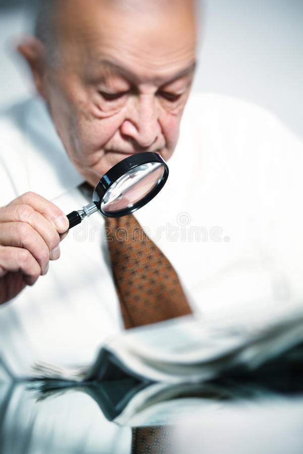 Download Old man with magnifier stock image. Image of mature, male - 16648903
