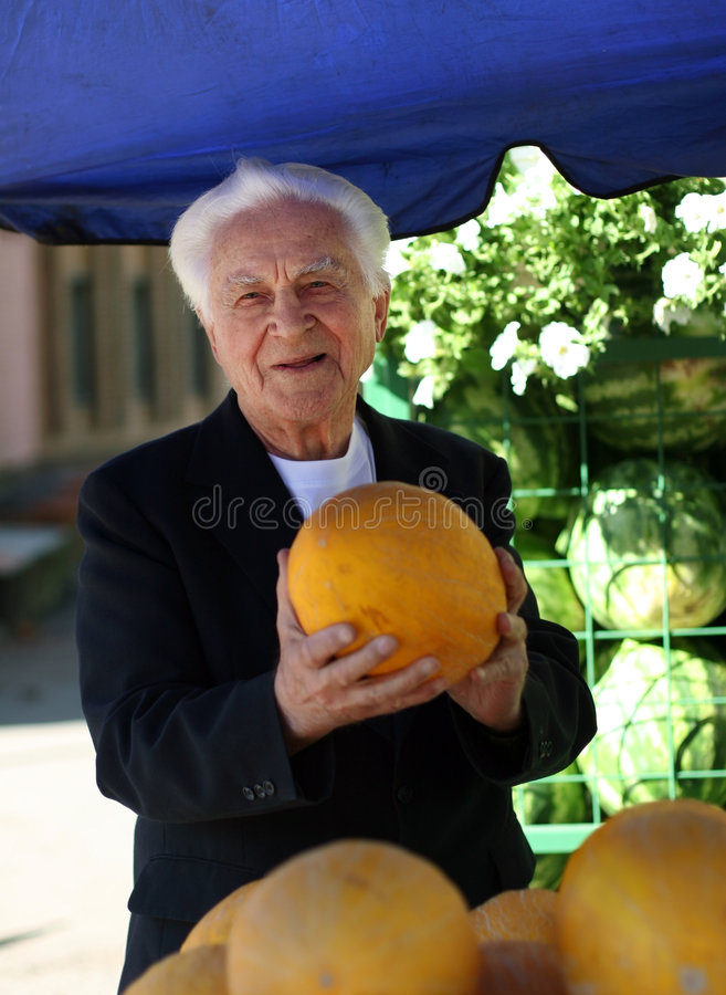 Old man at the marketplace royalty free stock photo