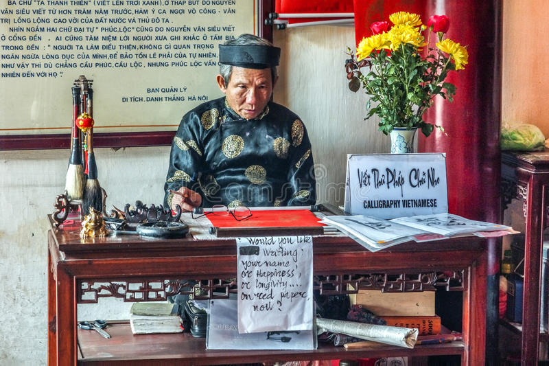 Old man offers calligraphy in Ngoc Son temple, Hanoi. HANOI, VIETNAM - CIRCA MARCH 2012: Old man offers calligraphy in Ngoc Son temple. Staring as if he was a royalty free stock image