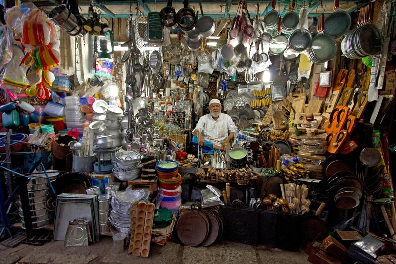 The old man in the overloaded shop. From Devaraja Market, Mysore, India royalty free stock images