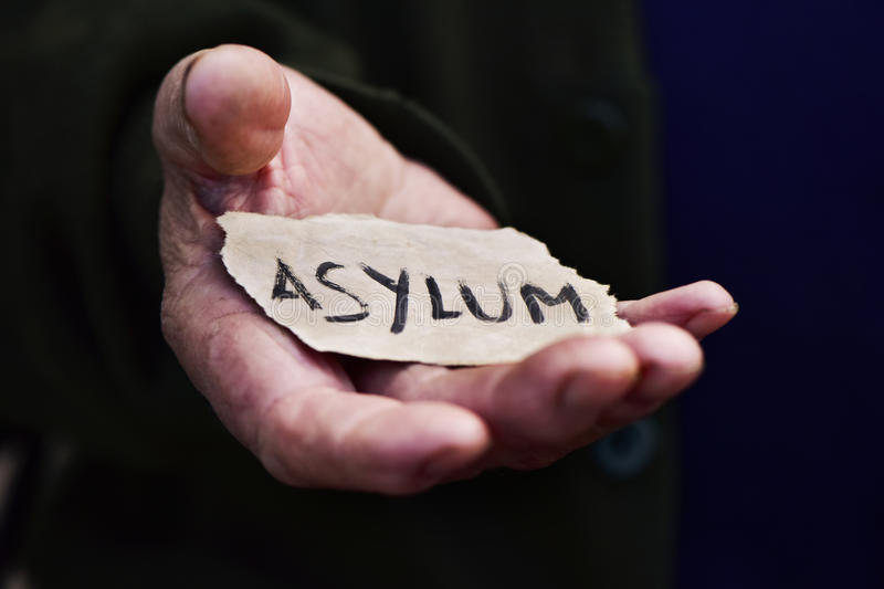 Old man with a paper with the word asylum royalty free stock photos