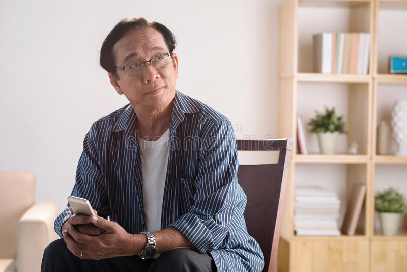 Old man with phone stock images