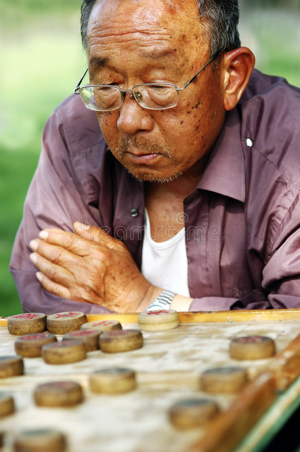 Free Old Man Play Chinese Chess Royalty Free Stock Image - 5093416