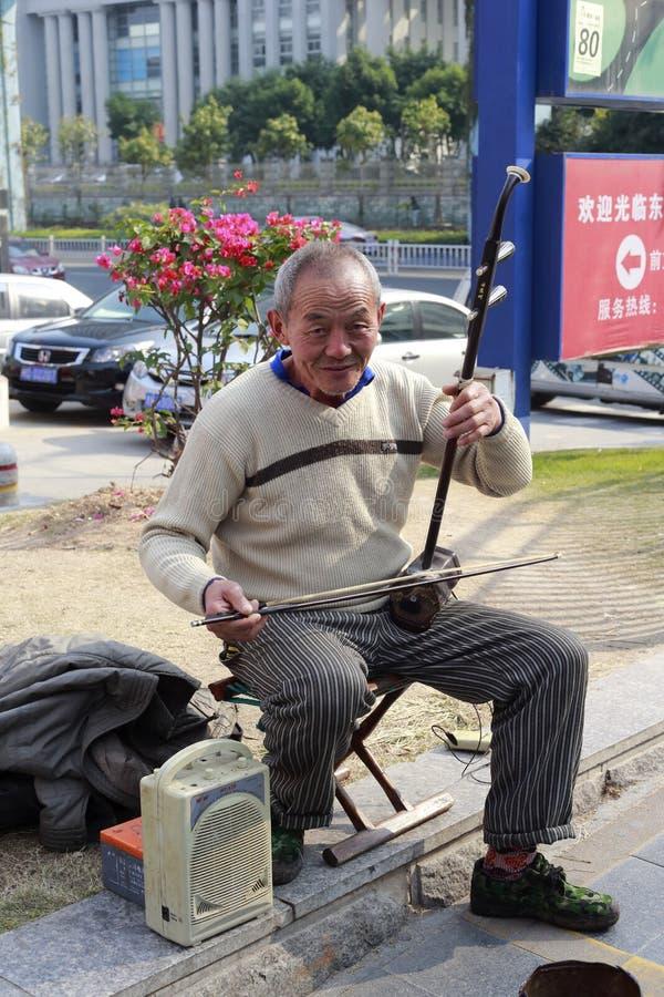 Free Old Man Playing An Erhu Royalty Free Stock Image - 36306356