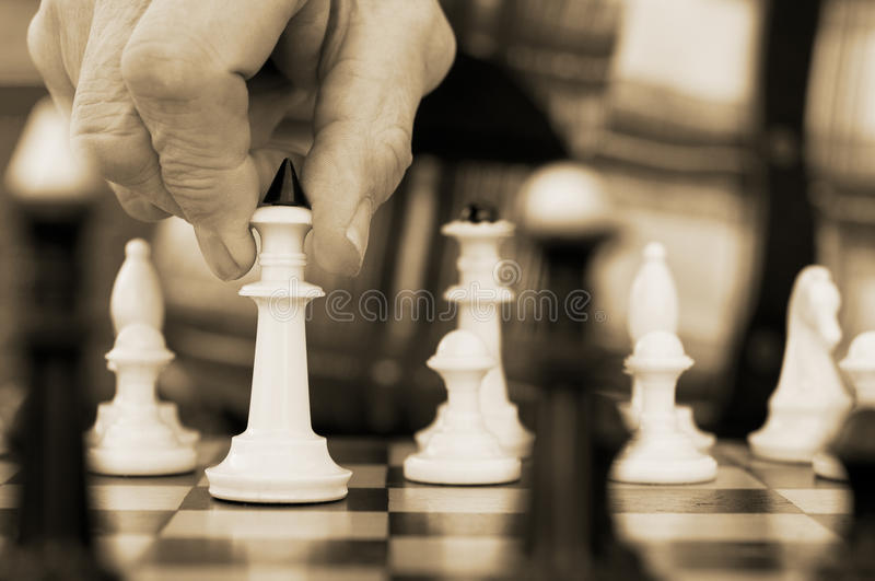 Old Man Playing Chess Royalty Free Stock Image