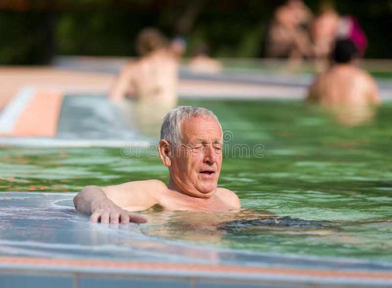 Old Swimming Pool : Old man in the pool stock photo image