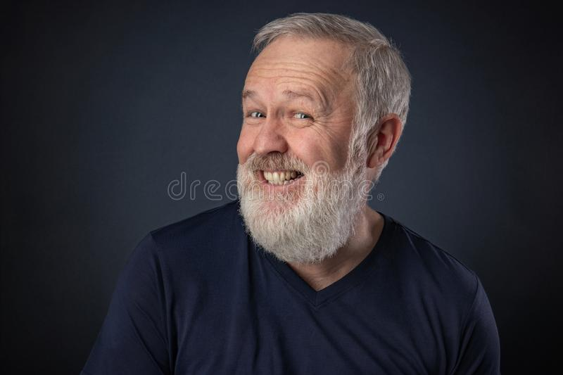 Old man pretending to laugh stock photo