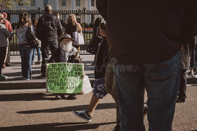 Old man protesting in front of White House stock photo