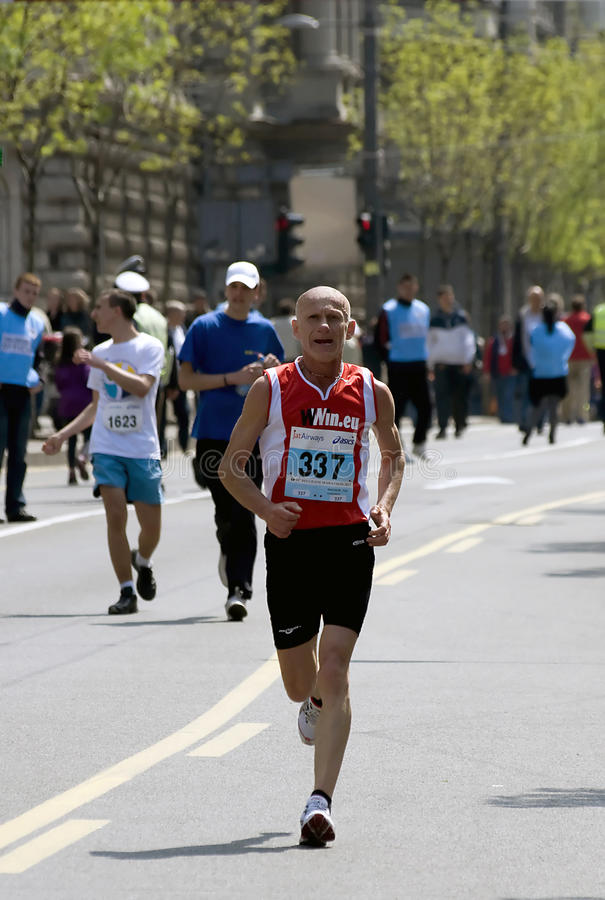 Old Man Runner Near The Finish Line Editorial Photography