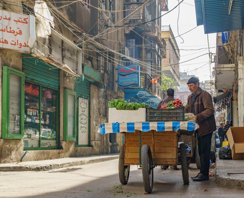 Old man sells fruits in the narrow street of Tripoli Lebanon stock photos