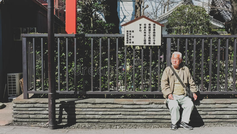 The old man is sitting on the bench. Asakusa , Japan royalty free stock photo