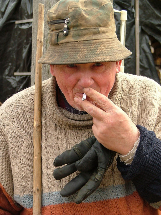 Old Man Smoking A Cigarette Royalty Free Stock Photography